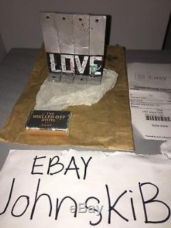 Banksy Walled off Hotel wall section souvenir. Kaws Warhol brainwash